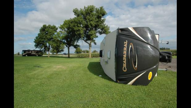 High winds in 2014 toppled a new camper on display by Holiday RV near the intersection of Highways 30 and 4. HERALD FILE PHOTO