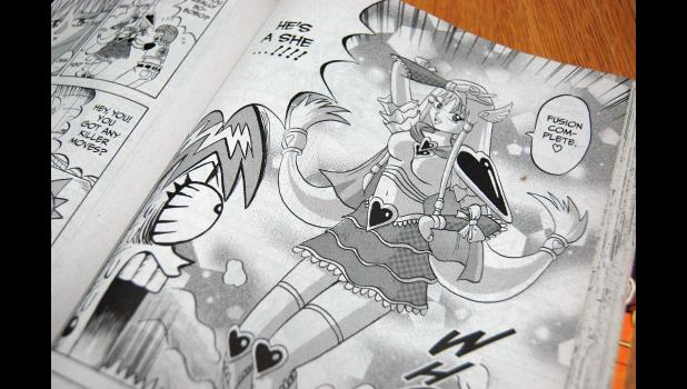 """Amber Love is slowly building a collection of manga (Japanese comics) at the Paton Public Library through donations from family, friends and fellow fans. One preteen patron is already hooked on the library's collection of """"One-Punch Man."""" ANDREW McGINN 