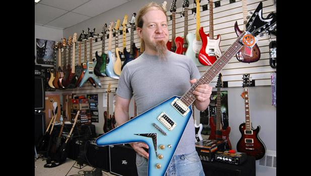 "Ben Christopher has given guitar lessons to hundreds of students, but only ever had one lesson himself. ""The guy said learn the pentatonic scale,"" he said, ""and then the second lesson he never showed up."" A 1995 Jefferson-Scranton grad, Christopher manages BRG Music in Perry. ANDREW McGINN 
