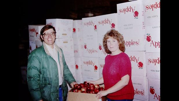 Jerald and wife Cindy, pictured in 1986, have grown the family apple orchard to include everything from a Christmas tree farm to a family fun zone with giant slides.