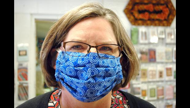 LeAnn Monaghan, of Jefferson, models one of the protective masks she sewed for health care workers in March. A national shortage of masks at the start of the COVID-19 pandemic led many medical facilities, including the Greene County Medical Center, to solicit their communities for homemade masks. HERALD FILE PHOTO