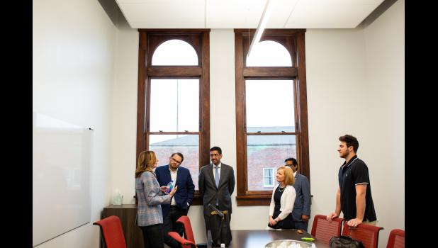 Standing between two newly restored, century-old windows at the Forge, U.S. Rep. Ro Khanna, D-Calif., speaks Saturday with Debra King (far left), chief information officer for Corteva Agriscience. Khanna sees Jefferson's new software design branch as a way to begin healing the nation, which has fractured among urban-rural lines. JACOB FISCUS | SPECIAL TO THE JEFFERSON HERALD