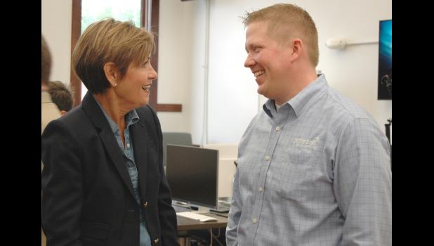 Iowa Gov. Kim Reynolds (left) visits Saturday at the grand opening of the Forge with Jamie Daubendiek, general manager of Jefferson Telecom, whose investment in broadband is regarded as critical to Accenture's decision in choosing Jefferson as the site of its first rural branch. ANDREW McGINN | JEFFERSON HERALD