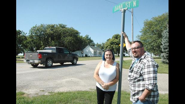 """It doesn't have to be crappy. It can be a nice town."" Dana Mayor Mandy Sims and husband Tony, a Dana city councilman, are on a crusade to save the town of Dana (pop. 71). A reroute of U.S. Highway 30 through town has called attention to the challenges they face. ANDREW McGINN 