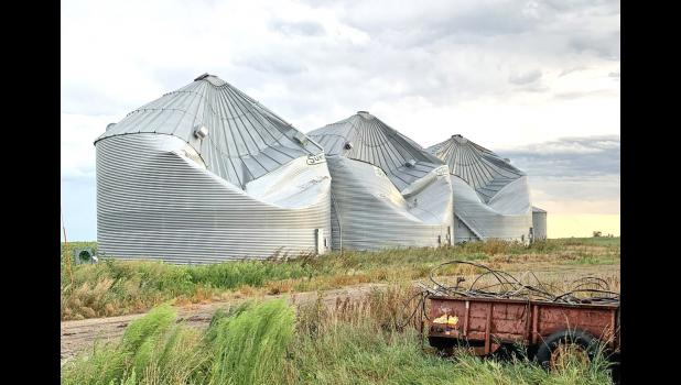 A trio of grain bins between Rippey and Grand Junction were severely damaged by high winds from a derecho on Aug. 10. The winds reached as high as 83 mph in Jefferson, according to the National Weather Service. PHOTO BY MEGAN HOLZ