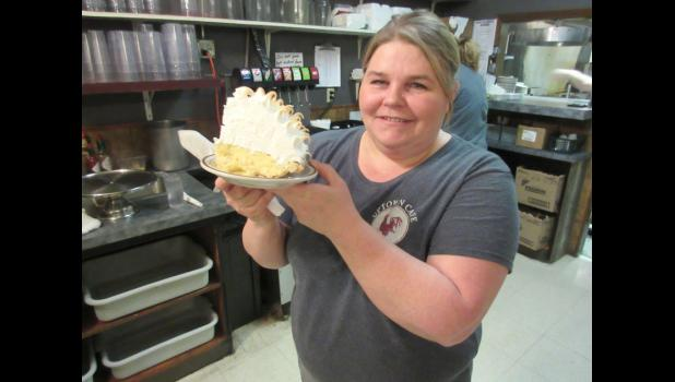 "Elaine McDowell, sous chef and chief baker at the Uptown Cafe, shows off a slice of her ""Mile-High Banana Cream Meringue Pie."" The Jefferson eatery has been voted as having the best pie on the Raccoon River Valley Trail."