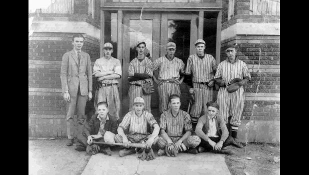 An undated Churdan baseball team. Roy Mosteller, who died in 1989 at age 83, is pictured second from right in the front row. Maybe more than anyone, he kept the memory alive of playing against Bob Feller in the era of townball.
