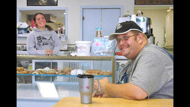 The three R's: The Schroeders bought Bunkers' recipes, reputation and even regulars like Matt Bradley (right). Daughter Kara Schroeder is pictured in the background.