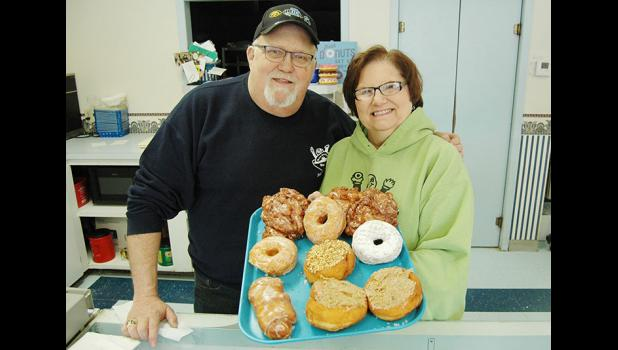 """We think we made the right choice,"" Randy Bunkers (left) says of his successor, Matt Schroeder. Randy and wife Phyllis retired Sept. 9 from their doughnut shop, picking Schroeder from the nine people who expressed serious interest in buying Bunkers Dunkers. All nine ""wanted it bad,"" Bunkers says. HERALD FILE PHOTO"