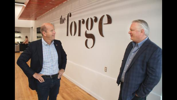 Democratic presidential candidate John Delaney (left) talks Sunday with Accenture's Linc Kroeger at the Forge in Jefferson. DOUGLAS BURNS   JEFFERSON HERALD