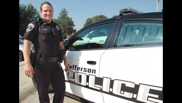 """Ashley Wilson says she never understood why cops walk a certain way, until she put the gear on herself. """"It's not easy getting into the vehicle,"""" she says. Police Chief Mark Clouse said Wilson """"immediately popped out as an excellent fit"""" for the department. ANDREW McGINN 