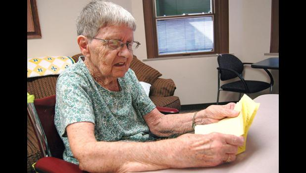 Waunita Collogan, a resident of Long Term Care, reads a recent letter from her pen pal of 75 years in California. ANDREW McGINN | JEFFERSON HERALD
