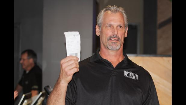 Iowa State University Hall of Fame linebacker and former San Diego Charger Dennis Gibson shows off his ticket Oct. 3 for the first legal sports bet at Wild Rose Casino. The former Cyclone put $500 down for ISU to cover the spread against TCU on Saturday. BRANDON HURLEY | JEFFERSON HERALD