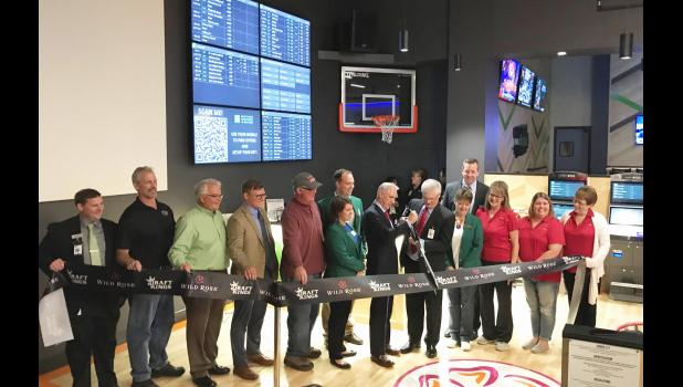 Wild Rose Casino COO Tom Timmons and Draftkings chief compliance officer Tim Dent join forces with local representatives Oct. 3 for a ribbon-cutting at the opening of a local sportsbook. BRANDON HURLEY | JEFFERSON HERALD