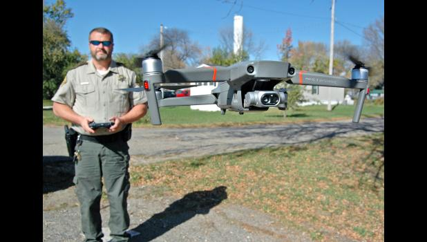 """Greene County Sheriff Jack Williams credits his new drone with playing a crucial role in the Sept. 1 apprehension of a wanted man northwest of Jefferson who eluded capture three previous times. As Jefferson Police Chief Mark Clouse puts it, """"It's a huge tool. It's changing everything."""" ANDREW McGINN 