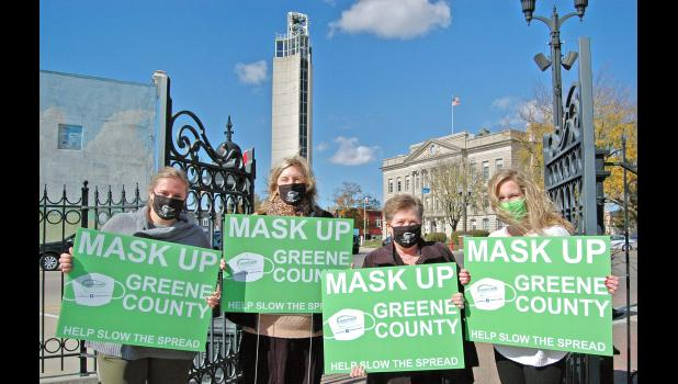 Greene County Medical Center staff on Oct. 16 distributed masks and signs encouraging local residents to do their part and mask up to fight COVID-19. From left: Administrative assistant Emily Neese, CEO Tracy Warner, COO Christa Simons and marketing specialist Sydney Bishop.