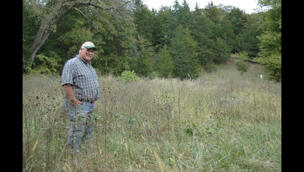 "Jeff Pudenz has allowed tall prairie grasses and wildflowers to flourish on his property near Churdan. But don't call him a tree hugger. ""I'm not liberal,"" he says. ""I'm not going to be planting marijuana."" ANDREW McGINN 