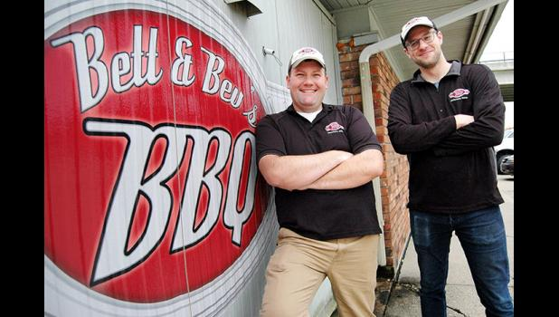 Brothers in barbecue: Adam Glawe (left), owner of Bett & Bev's BBQ in Jefferson, is entrusting longtime employee Kyle Roeder (right) with opening a franchise restaurant in Perry. ANDREW McGINN | JEFFERSON HERALD