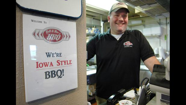 """Barbecue isn't sauce,"" Adam Glawe insists, ""it's meat."" The owner of Bett & Bev's BBQ, he's celebrating 10 years in his permanent location by planning to expand. ANDREW McGINN 