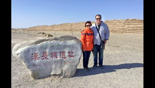 """Grand Junction resident Ralph Miller poses with wife Jiang Wei in 2017 at the Great Wall of the Han Dynasty in the Gobi Desert. As an """"international snowbird,"""" Miller and his wife spend their winters in her native China, a routine trip that was complicated this year by the onslaught of COVID-19. Their planned return to Iowa never happened."""