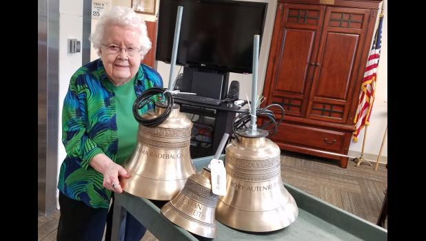 Velma Radebaugh poses at Long-Term Care in 2017 with new bells intended for the top of the Mahanay Memorial Carillon Tower inscribed with Radebaugh's name and the names of her sister, Vivian Autenreith, and nephew, Rory Autenreith. A teacher herself, Radebaugh carefully managed the Rory Autenreith Trust on behalf of her sister, growing it to more than $1.2 million.