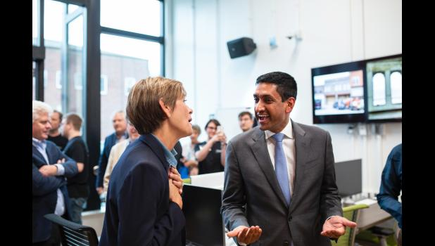 """Republican Gov. Kim Reynolds (left) and U.S. Rep. Ro Khanna, D-Calif., interact in Jefferson during opening festivities in 2019 for Accenture's $1.8 million Forge. Khanna has now introduced legislation to bridge the nation's tech divide. """"When we had manufacturing, we were connected,"""" he says. """"That's not the case right now with technology. If Google or Apple do well, it doesn't necessarily translate into wealth generation across the country."""" HERALD FILE PHOTO"""