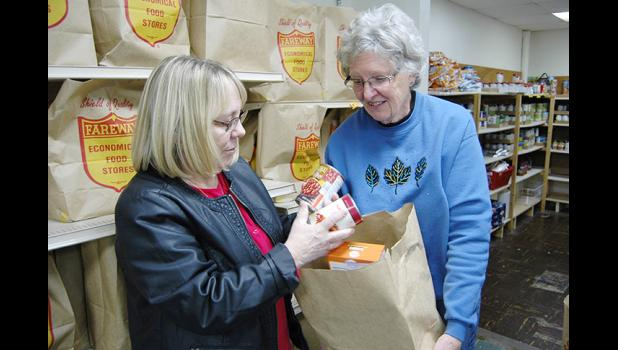 The Rev. Julie Poulsen (left) and site manager Dianne Blackmer started raising awareness last year about the need for a bigger food pantry. A year later, they're getting their wish. HERALD FILE PHOTO