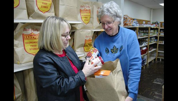 The Rev. Julie Poulsen (left) and site manager Dianne Blackmer believe the local, nondenominational food pantry is in need of a new facility, especially now that the roof leaks. ANDREW McGINN | JEFFERSON HERALD