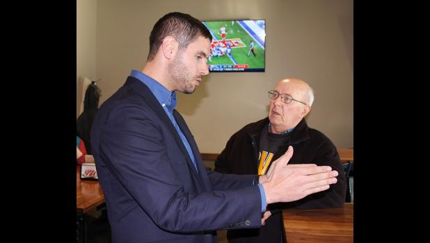David John (right), a retired Jefferson-Scranton teacher, speaks Sunday with Democratic candidate for governor Nate Boulton in Jefferson. Boulton is making education spending a priority in his campaign and wants to see stronger collective-bargaining positions for teachers. DOUGLAS BURNS | JEFFERSON HERALD