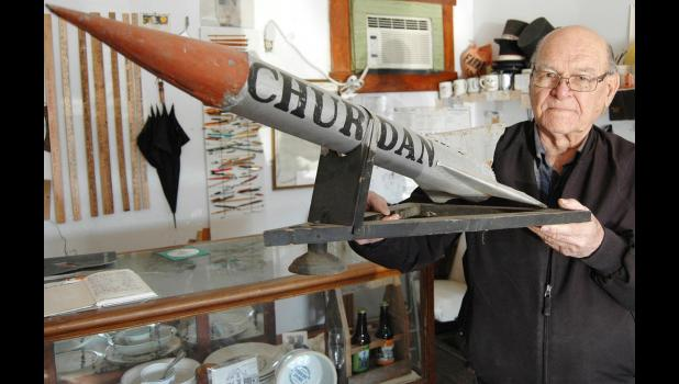 Paul White spent years tracking down one of the miniature rockets built by the Churdan Rocket Booster Club that fans used to strap to the tops of their cars during basketball season. ANDREW McGINN | JEFFERSON HERALD