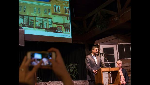 U.S. Rep. Ro Khanna, D-Calif., speaks Saturday night at History Boy Theatre at the national kickoff of R3 (Revive. Rebuild. Restore.) in Jefferson. Khanna was part of a delegation of Silicon Valley leaders who pledged to include rural America in their vision of the future. An architectural rendering of Pillar Technology's Jefferson Forge, planned to open next year in the vacant, century-old former IOOF building, is shown on a screen behind him.