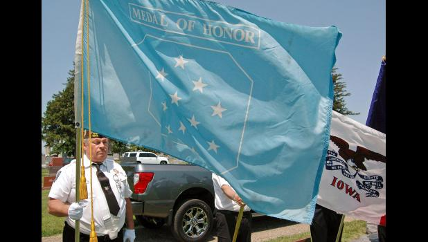 James Wasson, commander of Jefferson's Veterans of Foreign Wars Post 9599, stands in 2018 with the Medal of Honor flag at the funeral of Bill Kendall. A tireless champion of veterans both locally and nationally, Kendall conceived and designed the nation's official Medal of Honor flag. His flag concept soared through Congress in 2002 and was signed into law by then-President Bush. ANDREW McGINN | JEFFERSON HERALD PHOTOS