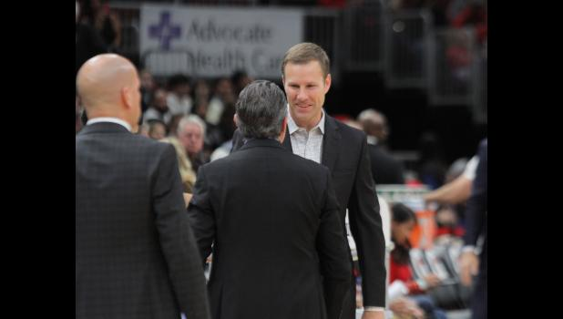 Chicago Bulls head coach Fred Hoiberg, an Ames native and former Iowa State University coach, chats with a Toronto Raptors assistant prior to a home game Nov. 17.  BRANDON HURLEY | DAILY TIMES HERALD