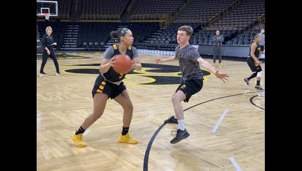 Former Greene County Ram Calvin Skalla (right) is a member of the University of Iowa women's scout team. The Hawks recently won the Big Ten Tournament title and are the top shooting team in the country. COURTESY OF THE UNIVERSITY OF IOWA