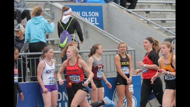 Greene County's Maddy Sigler begins the second leg of the 4-by-100-meter relay prelims at the 2019 Drake Relays last April in Des Moines. The Rams finished 89th with a time of 53.48.  BRANDON HURLEY | JEFFERSON HERALD