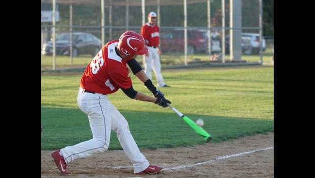 Senior first baseman Alex Rasmussen connects on one of his three hits in the Rams 16-9 victory over South Hamilton on June 22. The Rams improved their conference record to 8-3 with the win.