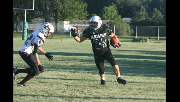 East Greene graduate Schyler Bardole (right) rushed for 1,742 yards (3rd in Iowa) and 29 touchdowns (7th) and returned two punts for touchdowns for one of the top teams in eight man in 2010 JEFFERSON HERALD FILE PHOTO