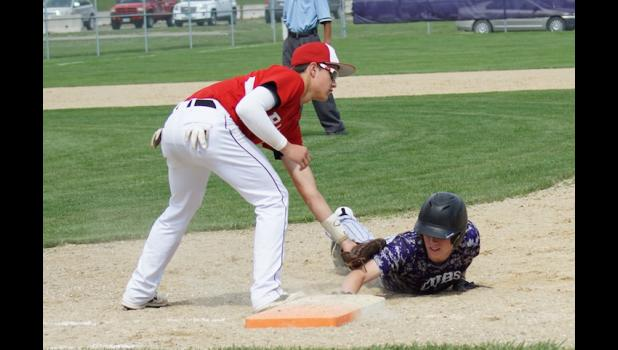 Chase Stoline tags a Nevada runner who dove back into first base. The Rams defeated the Cubs handlily 10-0 for their 19th win of the season.