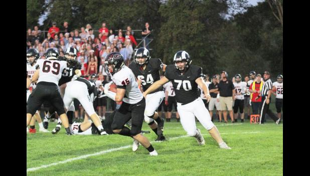 Greene County defenders Trent Custer (70) and Cole Betts chase down Gilbert running back Cooper Hurn during the Rams' 28-0 win Friday, Sept. 20 in Jefferson.  BRANDON HURLEY | JEFFERSON HERALD