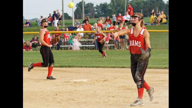 Second baseman Emma Saddoris throws to first base to put out a Kuemper runner in Greene County's 11-3 win over the Knights. Saddoris made some excellent defensive plays in the game and also drove in three runs with a home run and  a double.