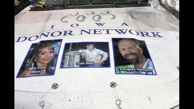 The late Doug Hamann (right), of Jefferson, was featured on the hood of Joey Gase's No. 52 car during the American Ethanol 250, a NASCAR Xfinity Series race, Saturday in Newton. Hamann, a member of the Jefferson-Scranton Class of '97, was an avid racing fan and also an organ donor.