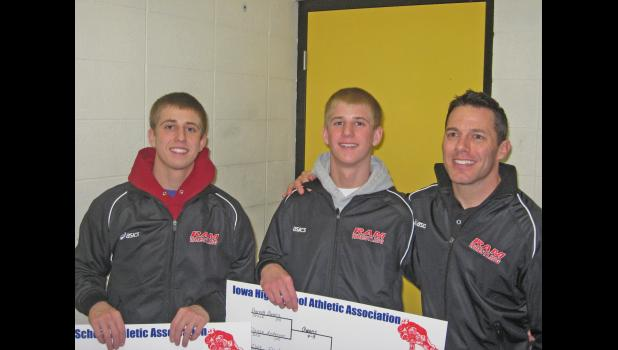 The Flack brothers, Chase and Clint (seen here with Greene County assistant Chris Connor) were instrumental cogs for the Rams wrestling team back in 2011. Chase, the school's all-time wins leader, passed away last summer.  PHOTO COURTESY OF CHRIS CONNOR