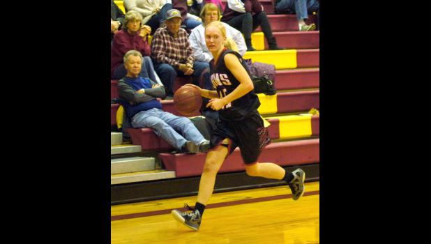 Kayla Mobley is pictured running down the court in the Rams game vs. PCM. She was the teams leading scorer with 21 points.