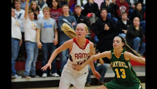 Junior Kayla Mobley is fouled while going for a loose ball in Greene County's conference opener on November 26. The Rams overcame a first half deficit to defeat a much improved Eagle team 49-44.