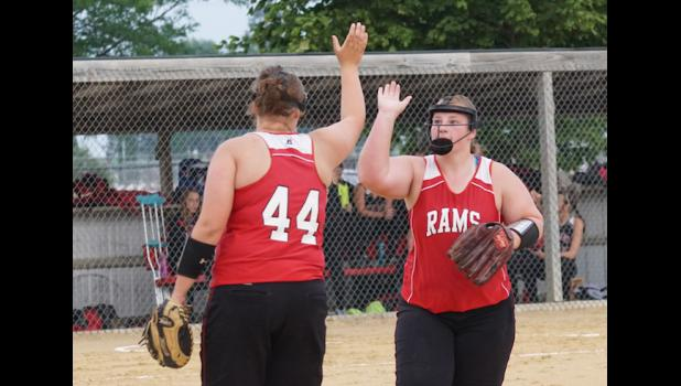 Ram pitcher Marissa Promes gets a high five after striking out all three Pocahontas Area  batters in the first inning. Promes had 10 strikeouts and no walks in Greene County's 10-2 victory.