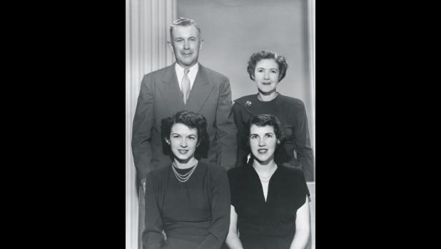 Rowena Miller is the young woman seated bottom left below her father Daniel Walker. Also pictured: Frances Walker (standing) and Betty Piepel (seated bottom right).