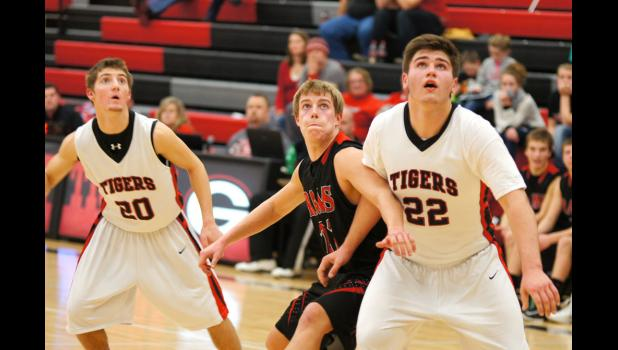 Sophomore Max Neese fights to get in position for a      rebound in the game conference game at Gilbert on Jan. 3. The Rams had a great second half, but couldn't catch up after falling behind by 20 in the first half.