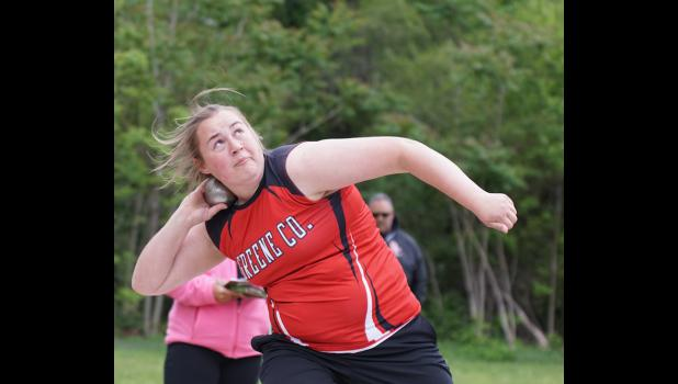 Hannah Onken won the discus title and set a new personal record in both the shot put and the discus at the Heart of Iowa Conference track meet on May 11.