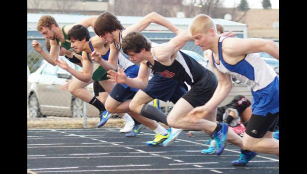 Senior Roman Phillips gets a good start on the 100 meter dash. Phillips set new meet records in the 100 and 200 meter dash events and anchored two winning relays at the Kip Janvrin Invitational in Panora on April 7.