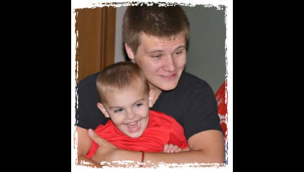 Jacob Peterson might have been homeless after his mom moved away for drug treatment if not for the Matt Roberts family of Jefferson. Jacob has lived with the family for almost three years while going to Greene County High. Here, he plays with the Roberts' grandson.